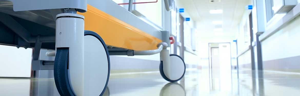 closeup of hospital bed in hallway